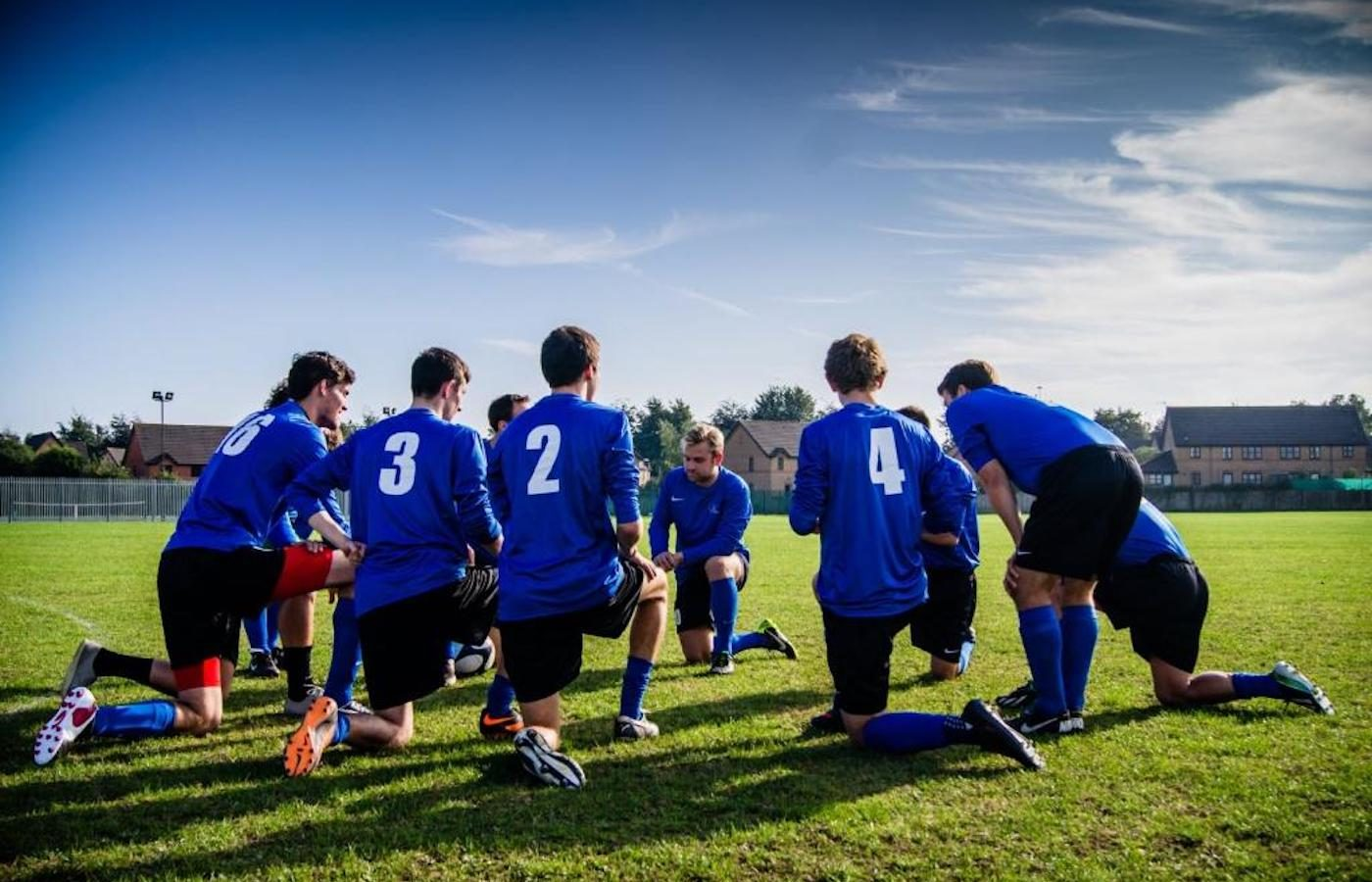 soccer team kneeling